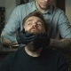 Handsome Man with a Long Beard and Undercut in Barbershop - VideoHive Item for Sale