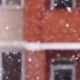 Snowfall in the City. Snowflakes Fly in the Background of a Window on House - VideoHive Item for Sale