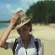 Girl Puts A Hat On His Head On The Beach - VideoHive Item for Sale