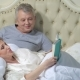 Senior Couple Reading a Book in Bed - VideoHive Item for Sale