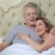 Couple Lounging in Bed After Awaking Cuddling - VideoHive Item for Sale