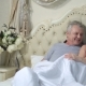 Excited Senior Couple Laughing Together in Bed - VideoHive Item for Sale