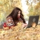 Woman with Laptop in the Autumn Park - VideoHive Item for Sale