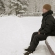 A Young Man Sits on a Bench in Winter Park and Admiring the Snow - VideoHive Item for Sale