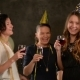 Group of Young Ladies at a Party Drinking Champagne and Wine Wearing Golden Caps - VideoHive Item for Sale