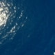 Zooming Out Aerial Shot of a Sailboat in the Blue Sea Background. - VideoHive Item for Sale