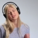 Emotional Young Blonde in Headphones Over White - VideoHive Item for Sale