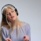 Emotional Woman with Headphones Listening To Music - VideoHive Item for Sale