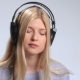 Beautiful Girl with Headphones Enjoying Music - VideoHive Item for Sale