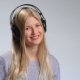 Teenage Girl Wearing Headphones Listens To Music - VideoHive Item for Sale