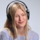 Blonde Girl with Headphones Listening To Music - VideoHive Item for Sale