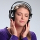 Calm Brunette Woman Enjoying Music in Headphones - VideoHive Item for Sale