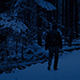 Man Walks In Snowy Woods At Night - VideoHive Item for Sale