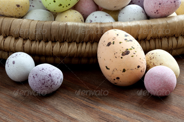 Easter eggs in a wicker basket - Stock Photo - Images