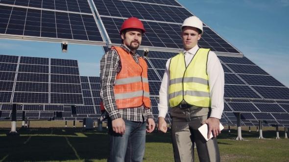 VideoHive Two Solar Power Engeneers Looking in Camera 19307434