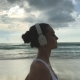 Woman Run On The Beach And Listen Music - VideoHive Item for Sale