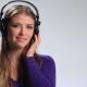 Smiling Girl in Headphones Listening Mp3 Player - VideoHive Item for Sale