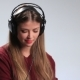 Playful Young Woman Enjoying Music in Earphones - VideoHive Item for Sale