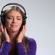Young Beautiful Woman Enjoying Music in Earphones - VideoHive Item for Sale