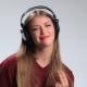 Happy Cheerful Girl Enjoying Music in Headphones - VideoHive Item for Sale