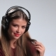 Provocative Young Brunette Posing with Headphones - VideoHive Item for Sale