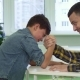 Father and Son Armwrestle on the Table - VideoHive Item for Sale