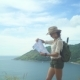 Woman With Backpack Monitoring Tourist Map In Hand - VideoHive Item for Sale