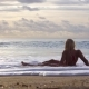 Young Woman Is Sitting on Beach in Bali - VideoHive Item for Sale