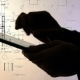 Silhouette of Hands Using Tablet PC While Working with Blueprints. - VideoHive Item for Sale