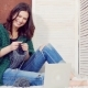 Young Beautiful Happy Girl Is Knitting a Sit at Home in Bedroom - VideoHive Item for Sale