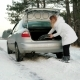 Girl Tries To Put a Spare Wheel, Young Woman in Difficult Situations on the Road, Highway Covered Nulled