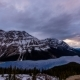 of Sun Setting Behind Clouds at Peyto Lake During Spring - VideoHive Item for Sale