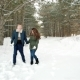 Beautiful Happy Couple in Love Walking in the Forest, Guy Hugs Girl,the Young People Out for a Walk Nulled