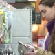 Young Woman Chooses Kitchen Utensils in the Supermarket - VideoHive Item for Sale