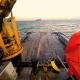 View From the Bridge Deck of the Tug on Anchor Buoy. Powered Winch. Daytime. Swell on the Baltic Sea - VideoHive Item for Sale