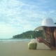 Woman In Swimsuit With Coconut Cocktail Laying On The Beach - VideoHive Item for Sale