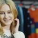 Portrait of Young Woman Model Looks at a Clothing Store - VideoHive Item for Sale