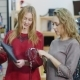 Two Stylish Lady in a Shop of Accessories and Clothes Are Choosing Handbags. Successful Shopping - VideoHive Item for Sale