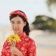 Beautiful Vietnamese Girl in Red Traditional Dress Ao Dai with Yellow Flowers - VideoHive Item for Sale