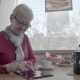 Senior Woman in Cafe Websurfing on Internet. An Elderly Man with a Tab - VideoHive Item for Sale