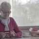 Mature Woman Makes an Online Purchase Using a Tablet in the Cafe. - VideoHive Item for Sale