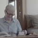 A Pensioner Spending Time in Cafes, Reading an Interesting Book - VideoHive Item for Sale