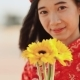 Beautiful Vietnamese Girl in Red Traditional Dress Ao Dai with Yellow Flowers. . - VideoHive Item for Sale