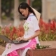 The Beautiful Asian Girl Speaks on a Laptop on the Street and a Beautiful National Dress Ao Dai with - VideoHive Item for Sale