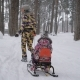 Happy Mother Quickly Stepping on the Path and Pulling Sleigh with Her Daughter in Winter Forest - VideoHive Item for Sale