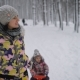 Mother with the Daughter Spend  Free Time Riding the Sledge.