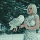 Owl Sitting on the Hand of a Beautiful Woman. Winter Forest - VideoHive Item for Sale