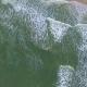 Aerial: Sea Waves at Beach
