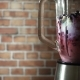 Blender with Blackberry and Kiwifruit Milk Smoothie on Kitchen