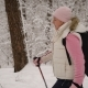 The Woman Quickly Goes Through the Snowy Forest. She Falls a Bit Under the Snow, Because It Is New Nulled
